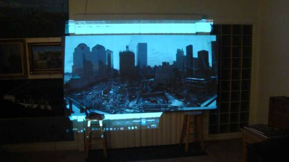 Sketching the main elements on the canvas using a projector. Its a very useful tool when you cant paint en plein air. Even Monet used a crude projector!